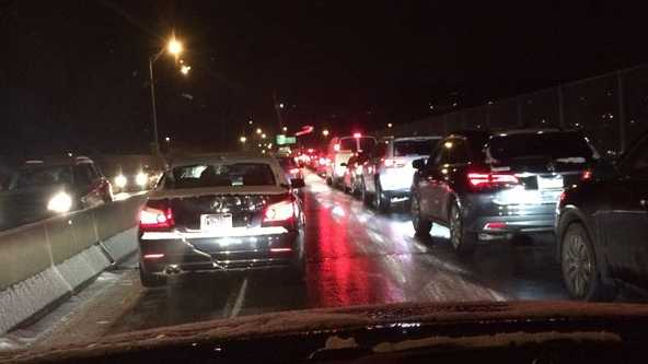 Traffic backed up on the Highland Park Bridge due to icy conditions Friday.