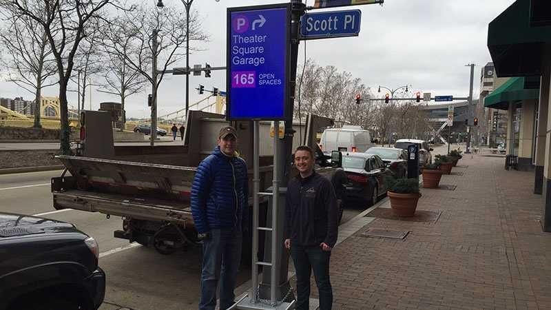 Digital signs on Fort Duquesne Boulevard tell drivers how many spaces are available in parking garages.