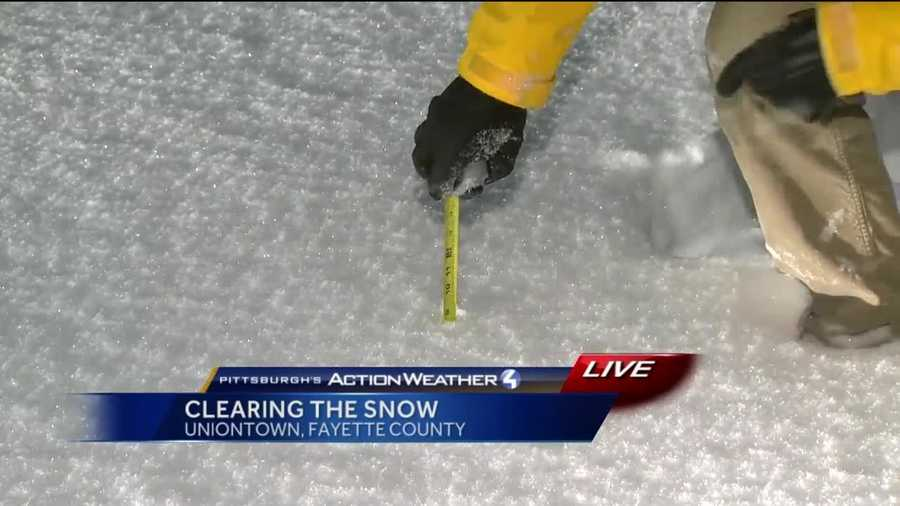 Reporter Bob Hazen shows the 8.5 inches of snow that had already fallen by 11pm Friday Night.