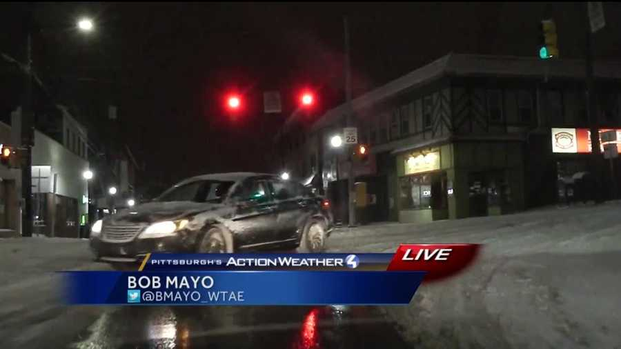 Reporter Bob Mayo reports live on road conditions in Squirrel Hill in Pittsburgh.
