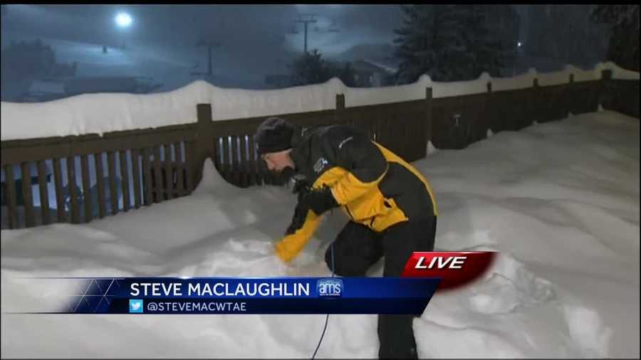 Meteorologist Steve MacLaughlin shows the 20 inches of snow that has fallen at Seven Springs Resorts in Somerset County.