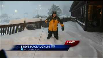 Meteorologist Steve MacLaughlin walks through the 24 inches of snow that has fallen in Somerset County in the 7am hour on Saturday.