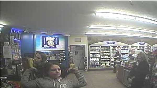Pittsburgh police are asking for help identifying the two women in this surveillance photo who are suspected of using a robbery victim's credit cards.