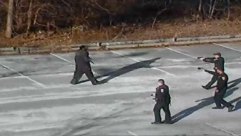 This surveillance image shows police trying to subdue Bruce Kelley Jr., who was armed with a knife.
