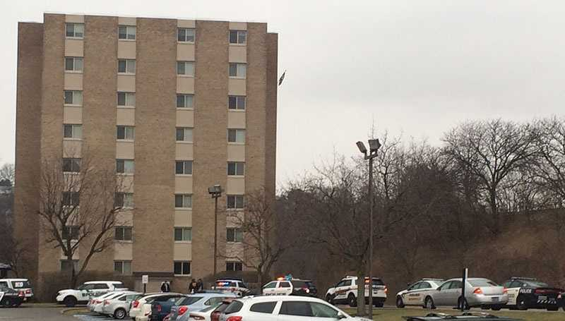 Police cars are lined up outside an apartment building at Penn Center East in Wilkins Township.