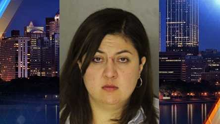 A woman was arrested after assaulting a bouncer and multiple police officers outside a South Side bar on Saturday.