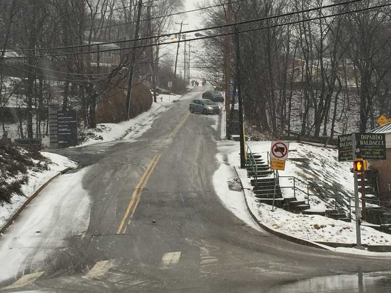 Cars were sliding sideways down Potomac Avenue because of slick conditions. This is the view from Banksville Road.