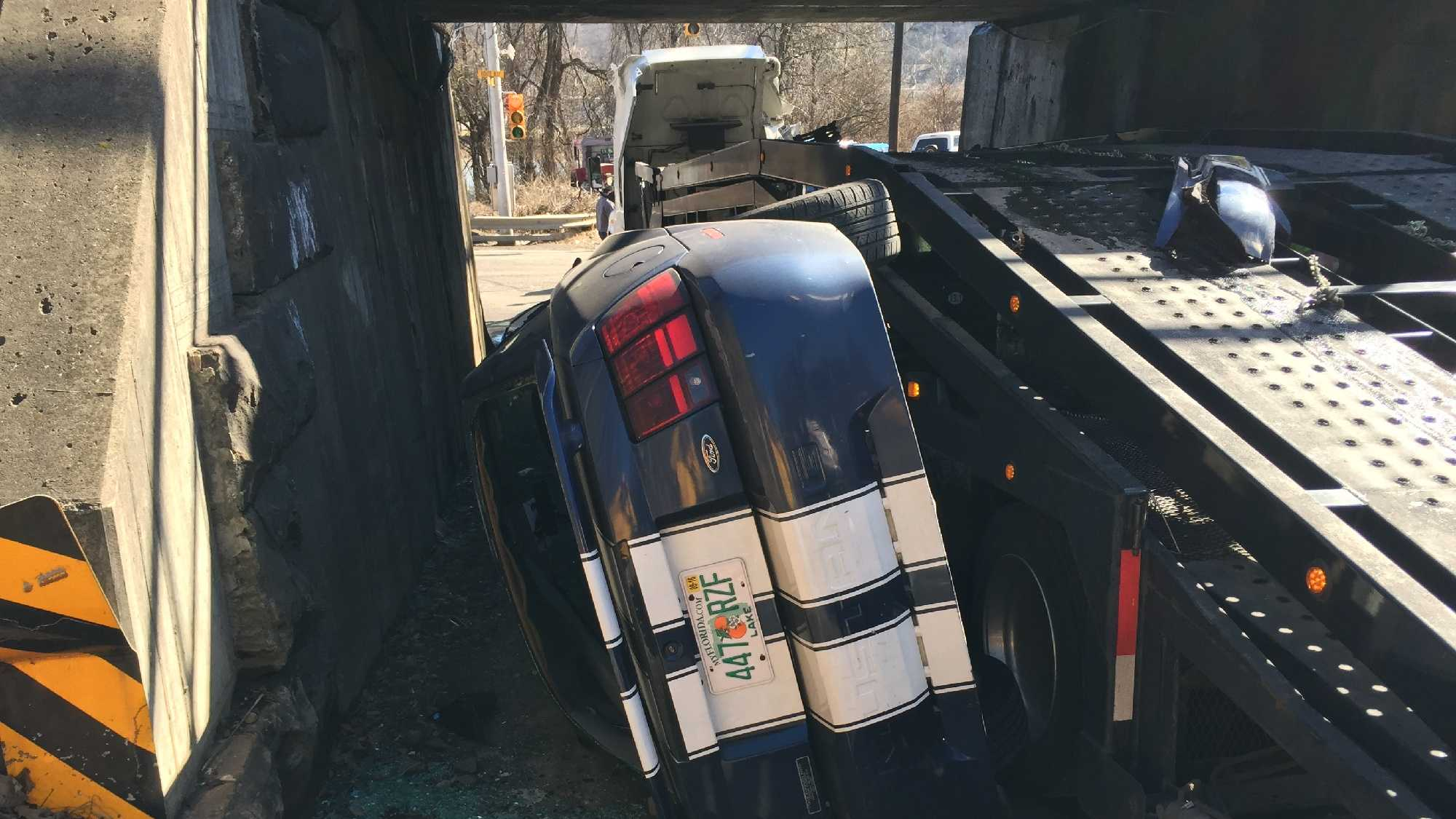 Two vehicles were damaged after a car carrier got stuck inside a tunnel in West Mifflin Sunday afternoon.