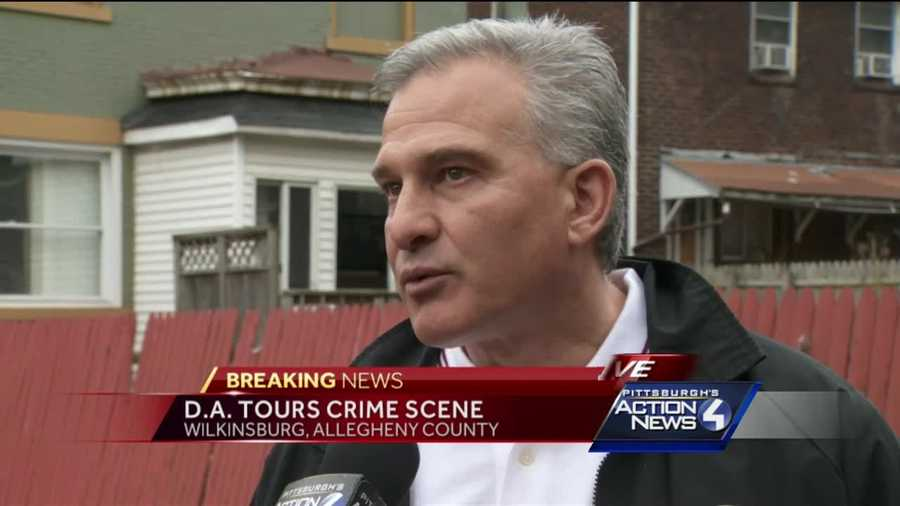 Allegheny County District Attorney Stephen Zappala tours the crime scene of the backyard ambush shooting in Wilkinsburg.