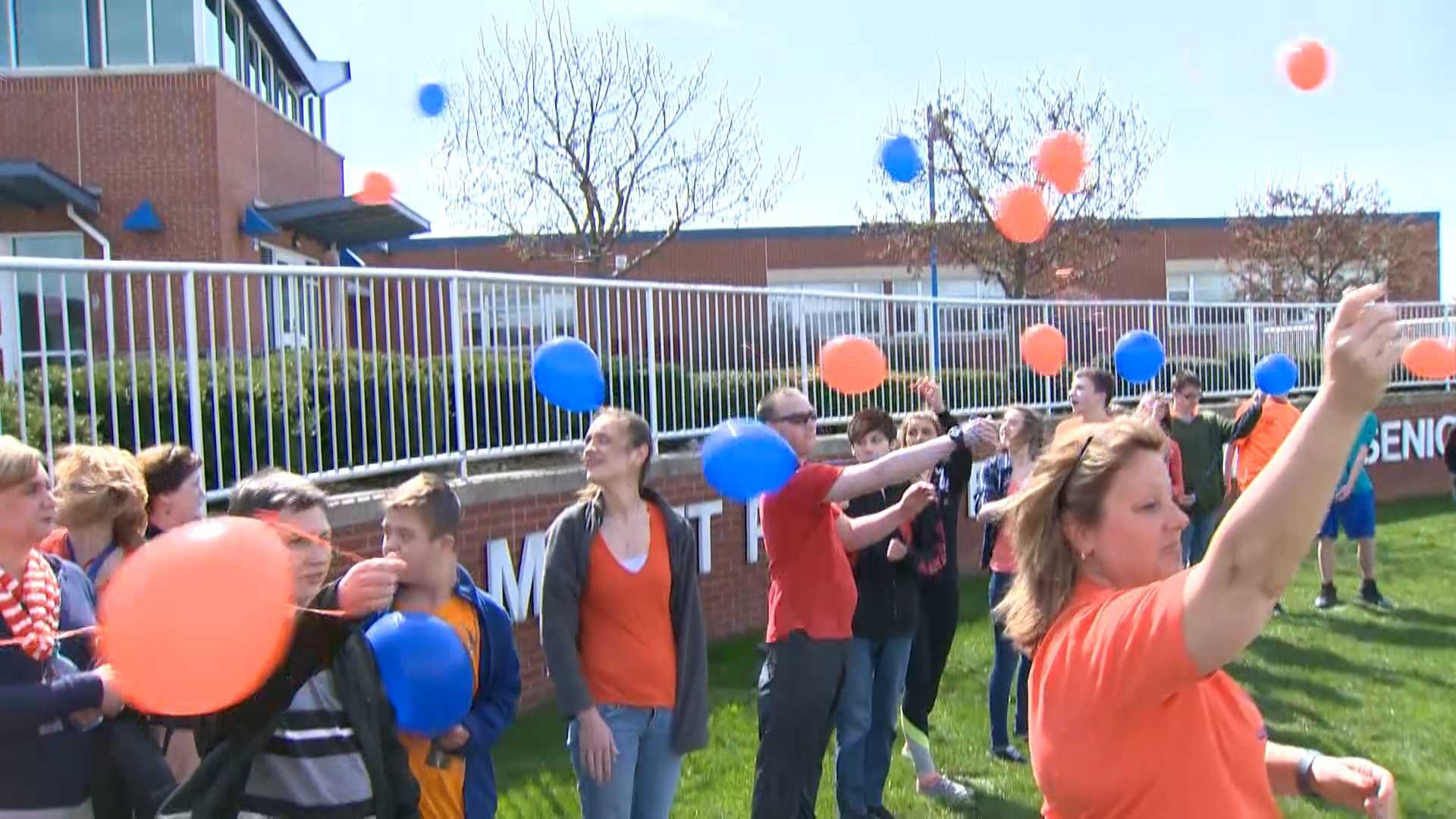 Classmates released balloons in memory of J.R. Gustafson at Mount Pleasant Junior High School.