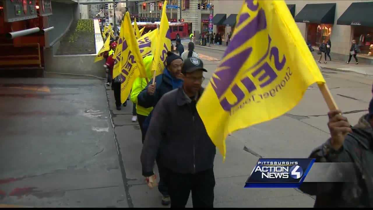 Service Employees International Union members, along with other community members, marched downtown Tuesday in favor of all downtown security officers being able to join 32BJ of the Service Employees International Union.