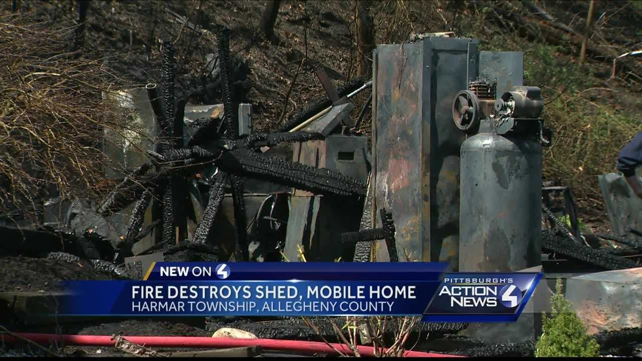 A quick-moving fire completely destroyed both a shed and a mobile home in Harmar Saturday afternoon.