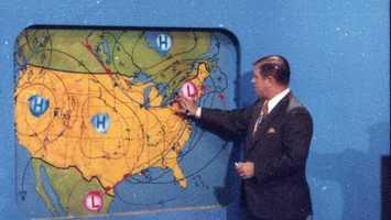 Legendary Chief Meteorologist Joe DeNardo in front of our weather wall in the 1960's.
