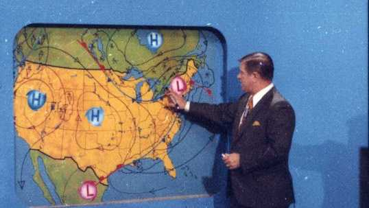 Legendary Chief Meteorologist Joe DeNardo in front of our weather wall in the 1960's.