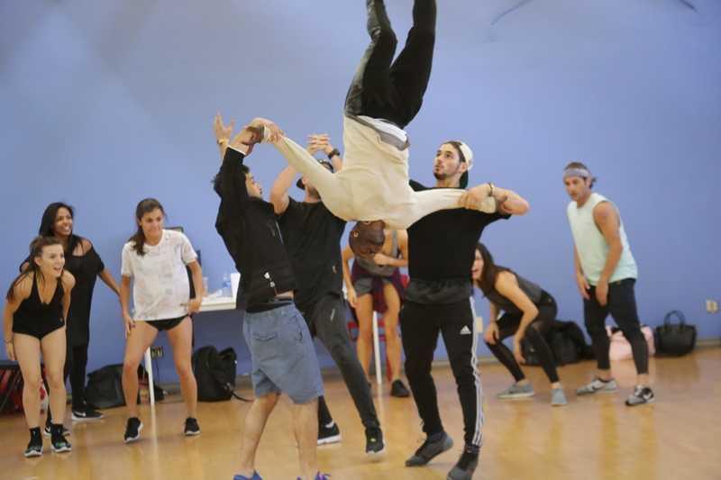 Antonio Brown does a flip in dance practice.