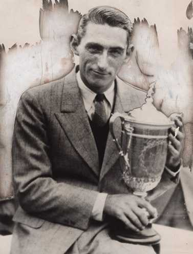 Photo shows Tommy Armour holding the trophy after winning the 1927 U.S. Open Championship held at Oakmont Country Club, Oakmont, Pa