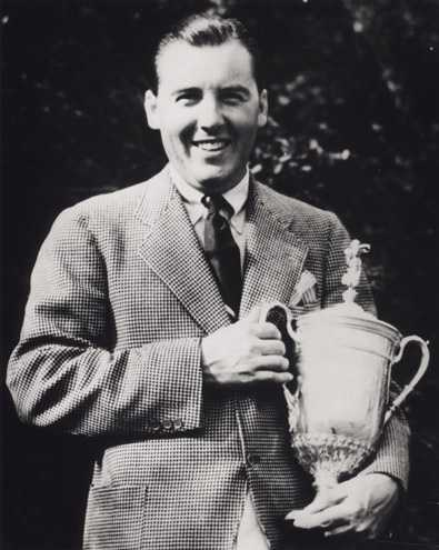 Photo shows Sam Parks Jr. holding the trophy for winning the 1935 U.S. Open Championship held at Oakmont Country Club, Oakmont, Pa.