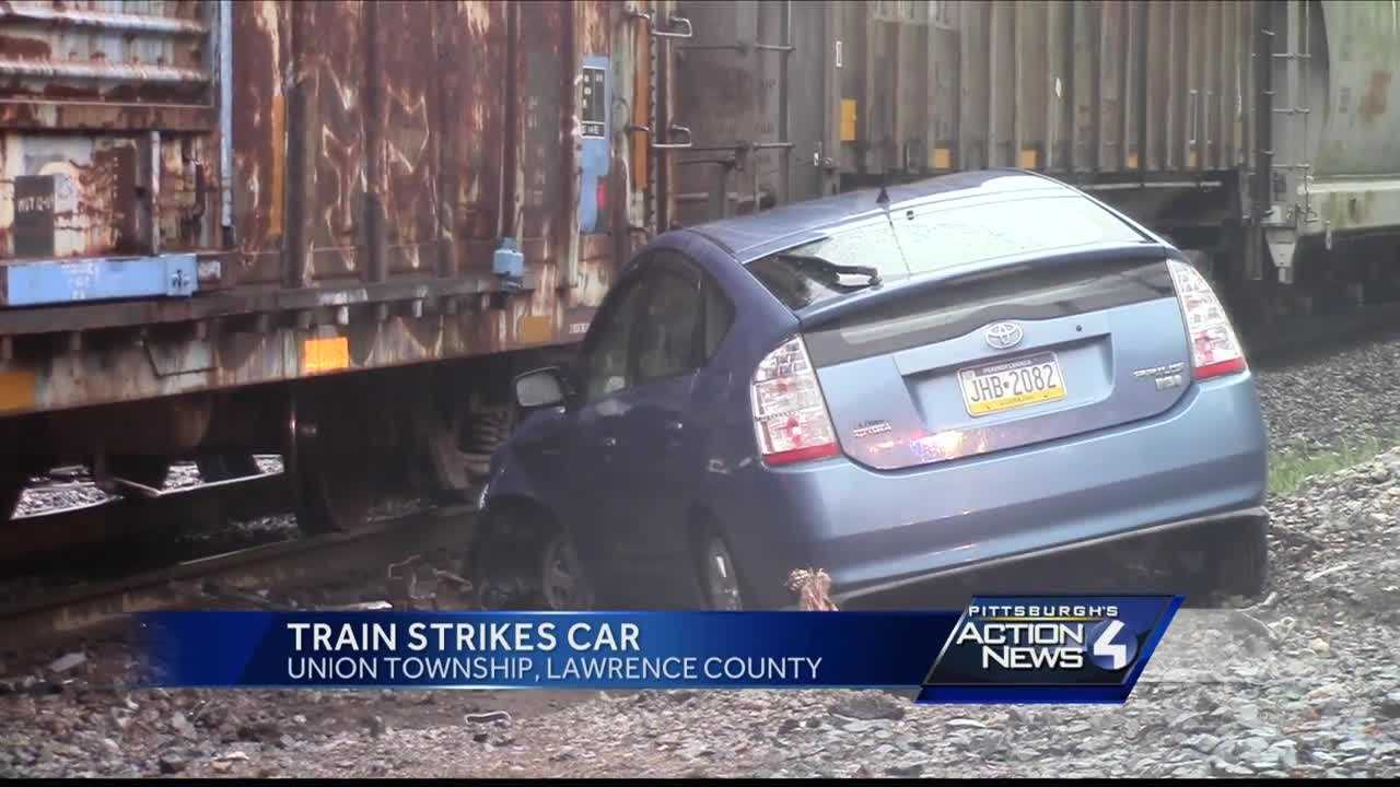 A woman was able to escape after driving onto railroad tracks before an oncoming train in Union Township.