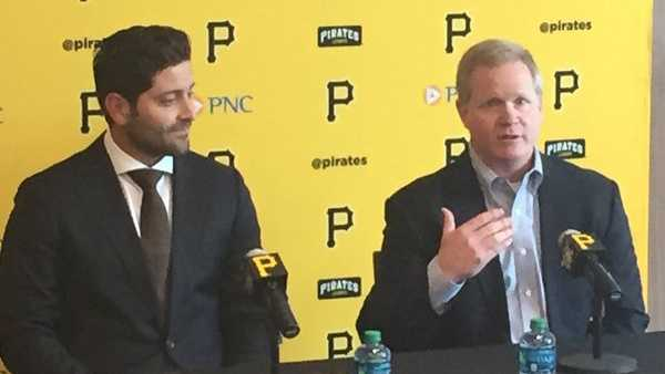 Pirates catcher Francisco Cervelli and general manager Neal Huntington.