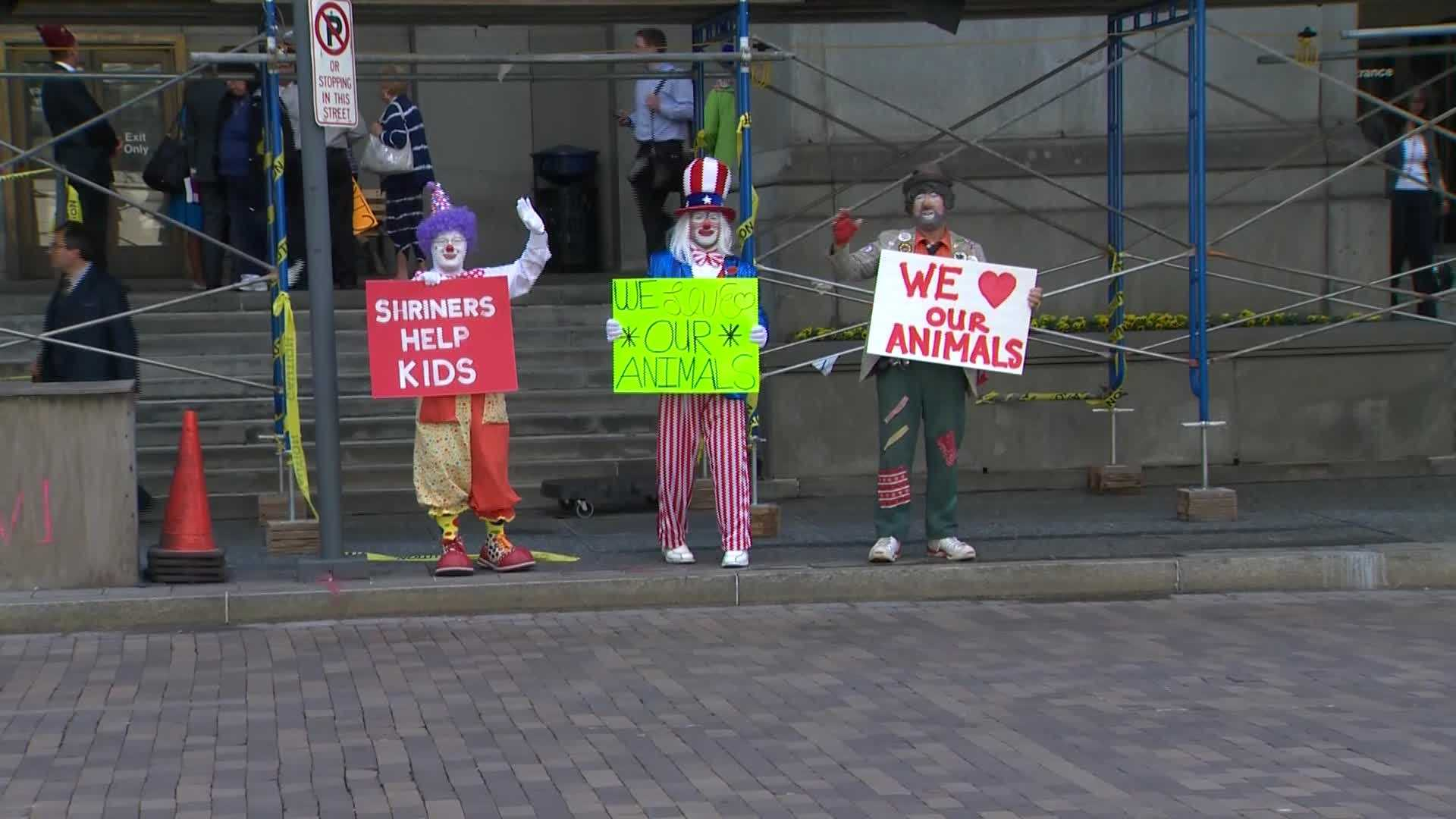 Clowns took to the streets to show opposition to legislation that would ban wild animal performances like the ones typically seen at the Shrine Circus.
