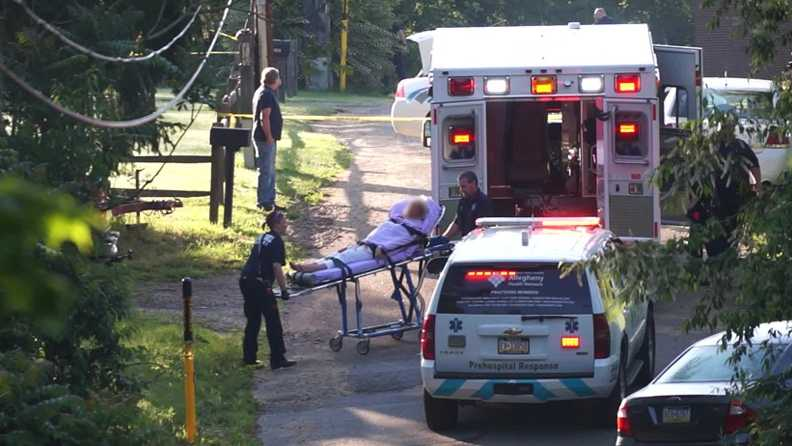 A woman was taken away in an ambulance after being shot in New Kensington.