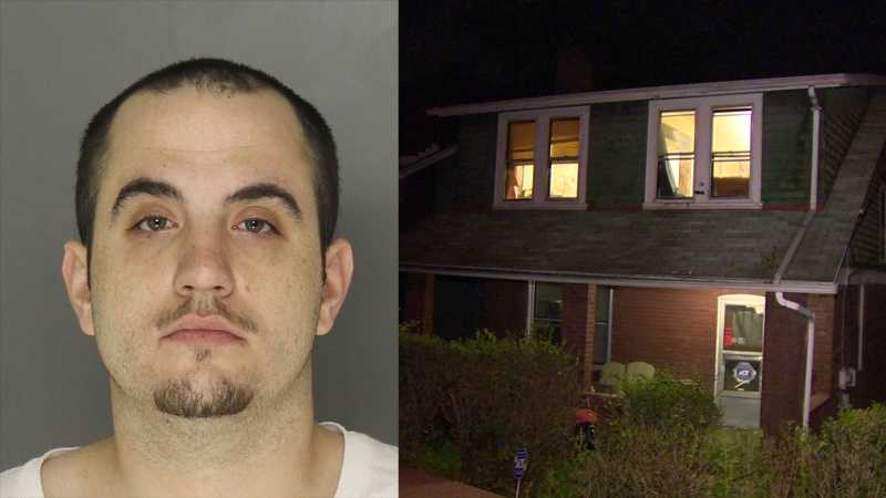 Police say Robert Hunter (pictured) is charged with killing Mark Lopata at this house on Harker Street in Elliott.