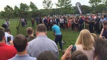 Rory McIlroy hits a golf ball at the Dick's Sporting Goods headquarters.