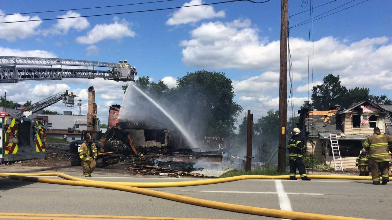 Former strip club Gloria's Cantina and a day care next door were destroyed by a fire Wednesday afternoon. (Andy Cunningham)