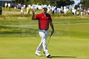 Kevin Streelman waves to the gallery on the 10th hole during a practice round for the 2016 U.S. Open at Oakmont Country Club in Oakmont, Pa. on Monday, June 13, 2016.