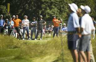 Dustin Johnson watches as Peter Hanson hits his tee shot on the eighth hole during a practice round for the 2016 U.S. Open at Oakmont Country Club in Oakmont, Pa. on Monday, June 13, 2016.