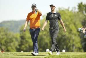 Sebastian Soderberg and Dustin Johnson walk off the tee on the eighth hole during a practice round for the 2016 U.S. Open at Oakmont Country Club in Oakmont, Pa. on Monday, June 13, 2016.