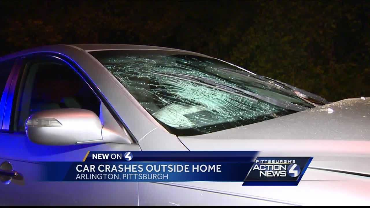 No one hurt when a car crashed outside of a home in Arlington