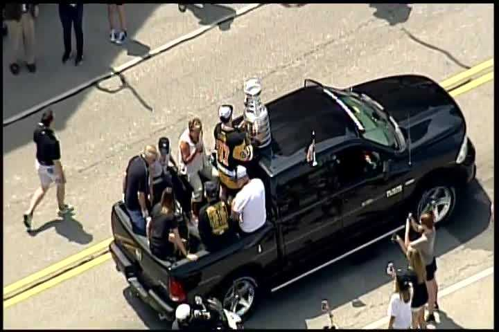 Sidney Crosby rides with the Stanley Cup in the Penguins