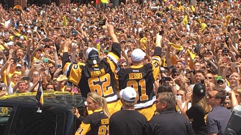 Carl Hagelin and Phil Kessel wave to the huge crowd of fans at the Penguins' Stanley Cup parade.