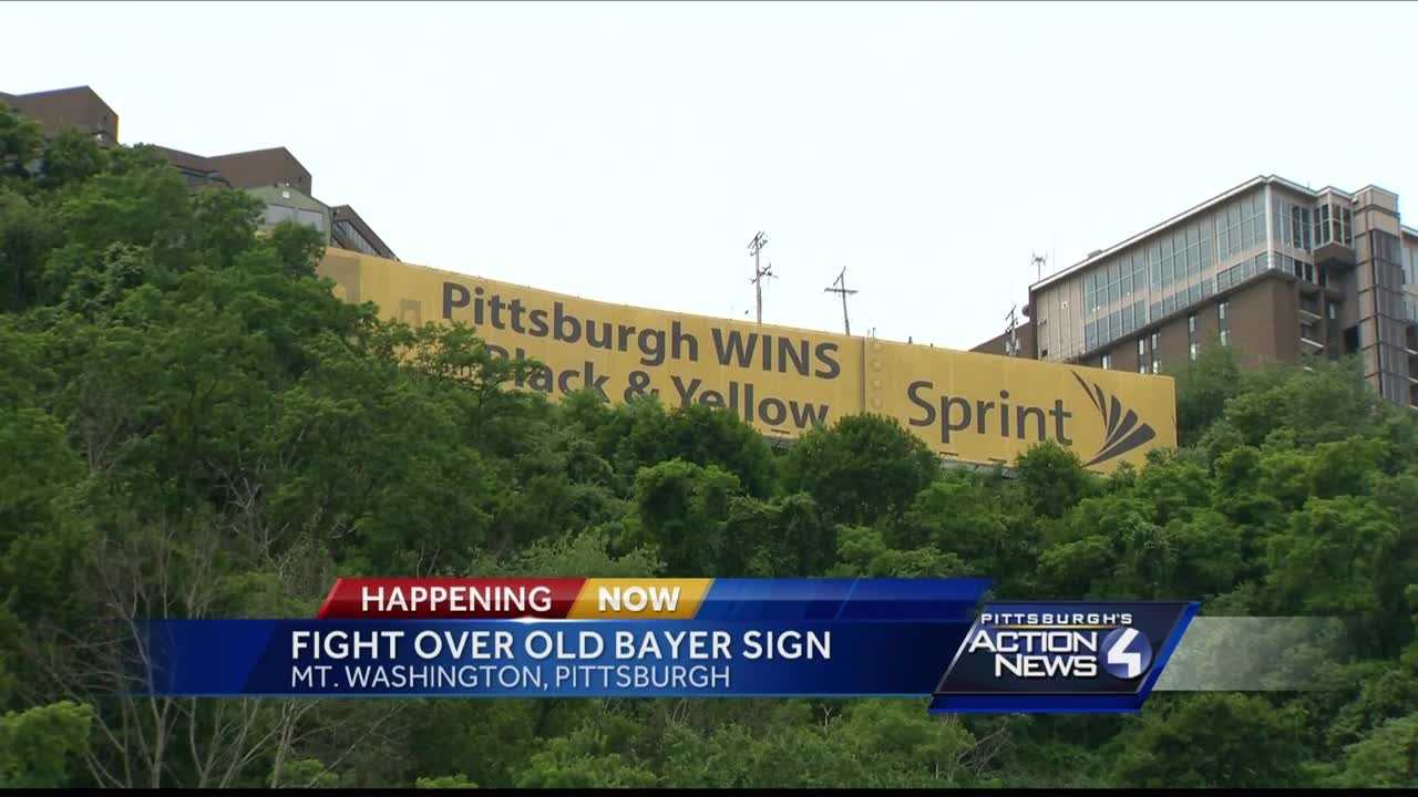 Lamar Advertising has agreed to repaint the back of the iconic Bayer sign on the side of Mt. Washington, but said Wednesday it has no plans to remove a vinyl advertisement placed over the sign three weeks ago, despite a city of Pittsburgh order to do so.