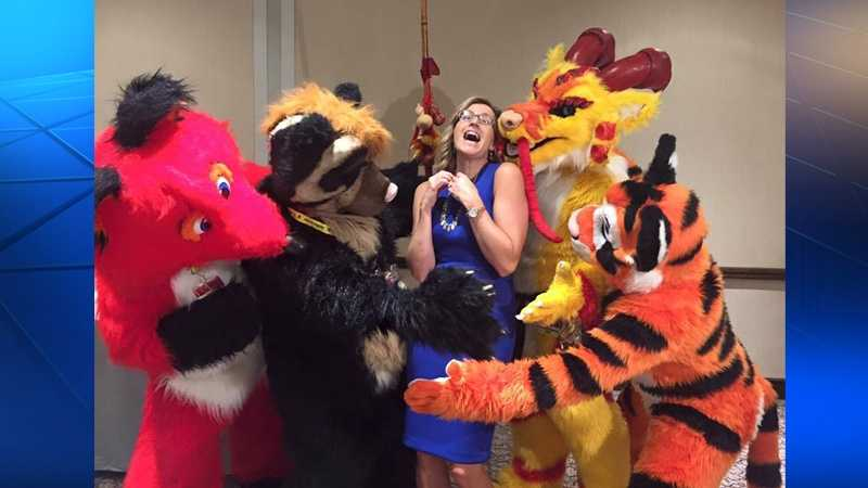 Shannon Perrine is surrounded by furries.
