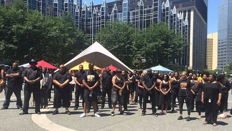 A group of people wearing black held a silent protest in Market Square.