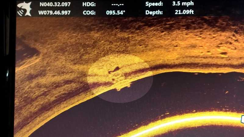 This image from a fish finder shows an object that is believed to be a car at the bottom of the water.