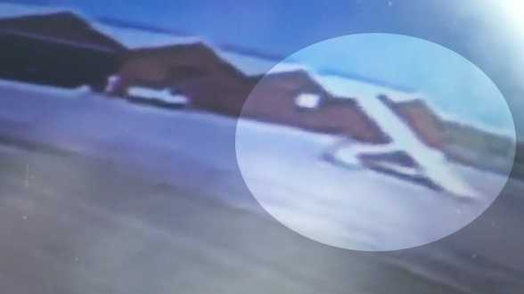 This image from surveillance video shows the plane as it spins out of control.