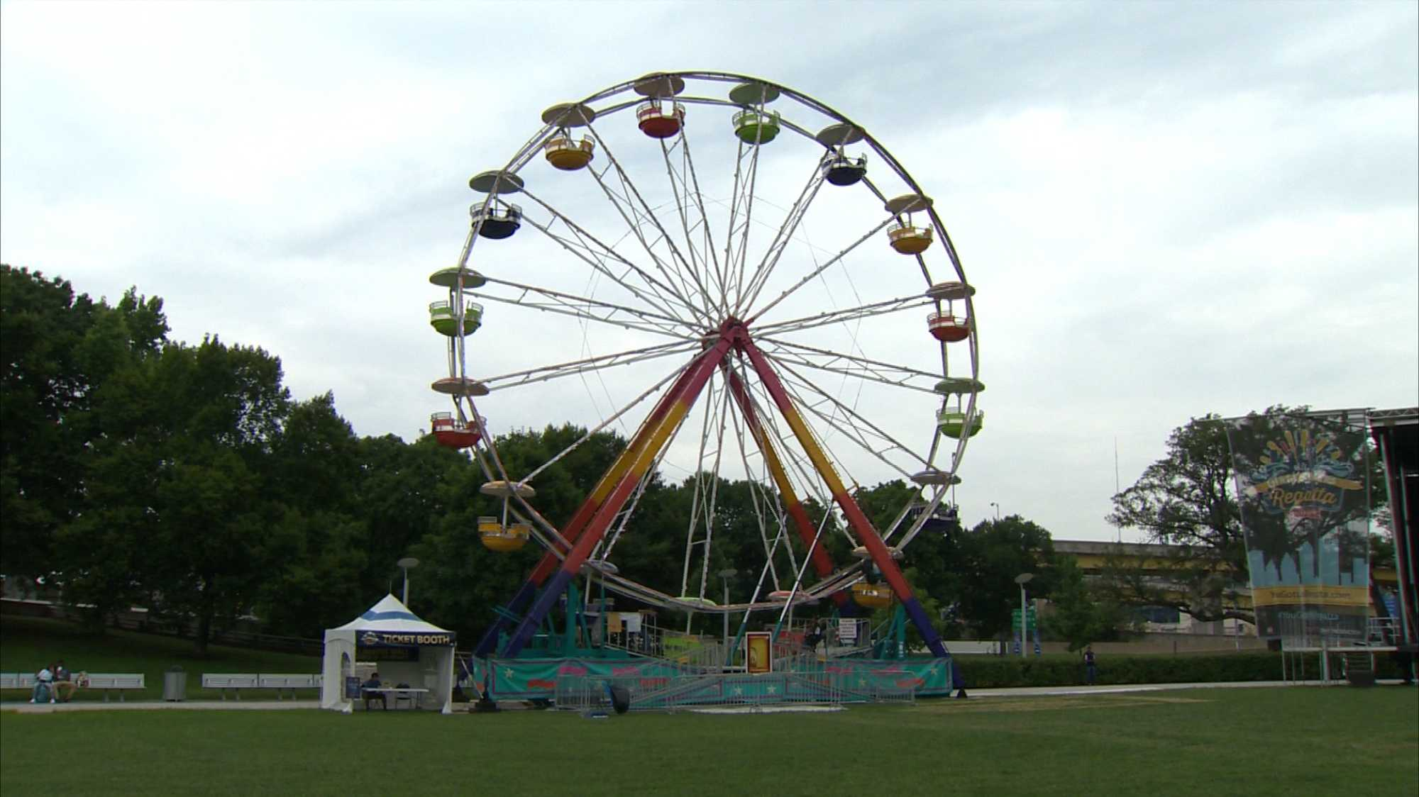 "A giant Ferris wheel called the ""Wheel of Lights"" is one of the main attractions at the EQT Pittsburgh Three Rivers Regatta."