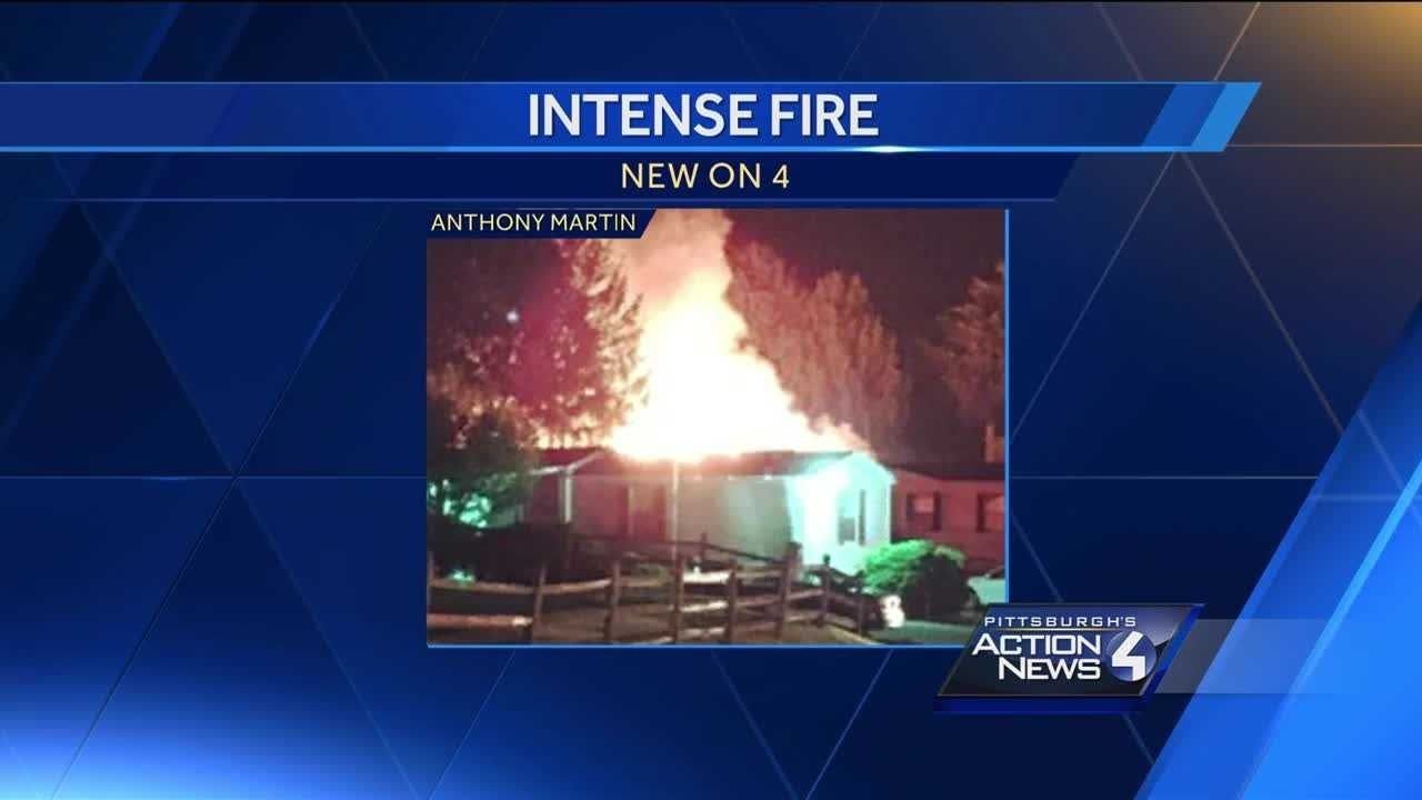 Fast-moving fire destroys home, damages 2 others