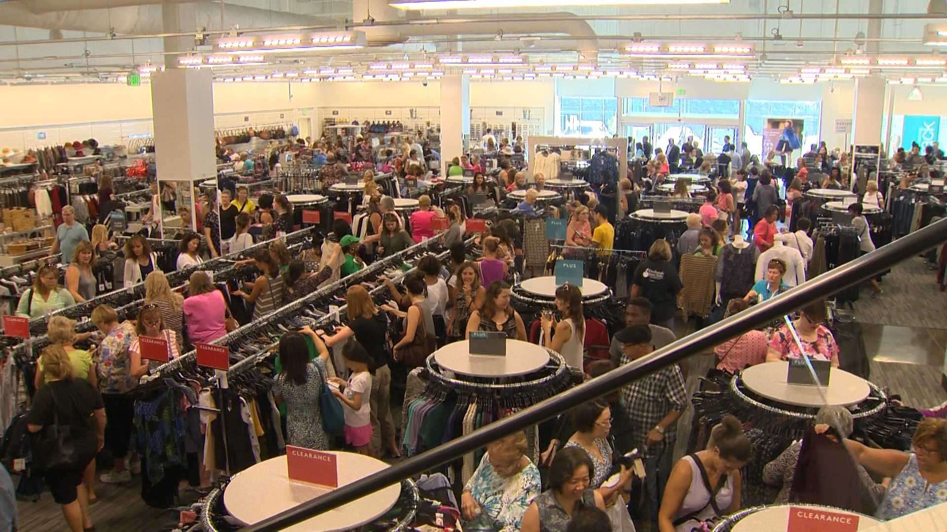 Shoppers browse the merchandise at Nordstrom Rack.