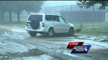 This vehicle on Connell Avenue was moved down the street by flood waters in Connellsville.