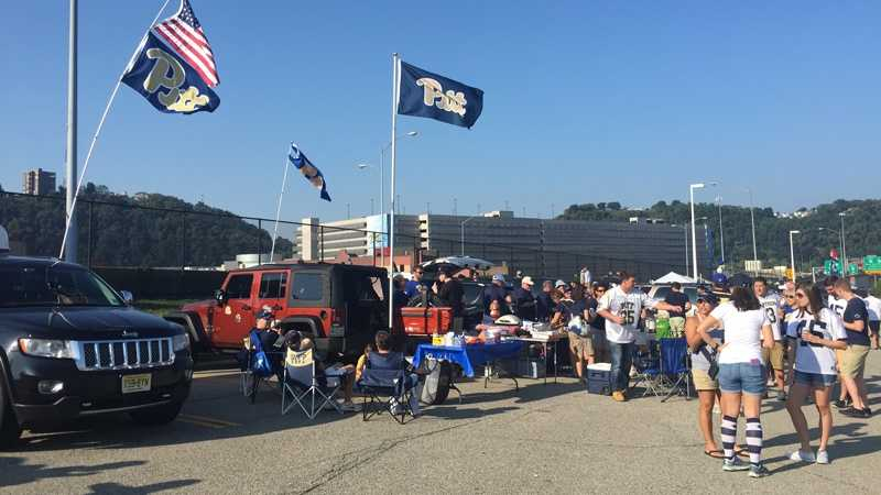 Pitt and Penn State fans at a football tailgate.