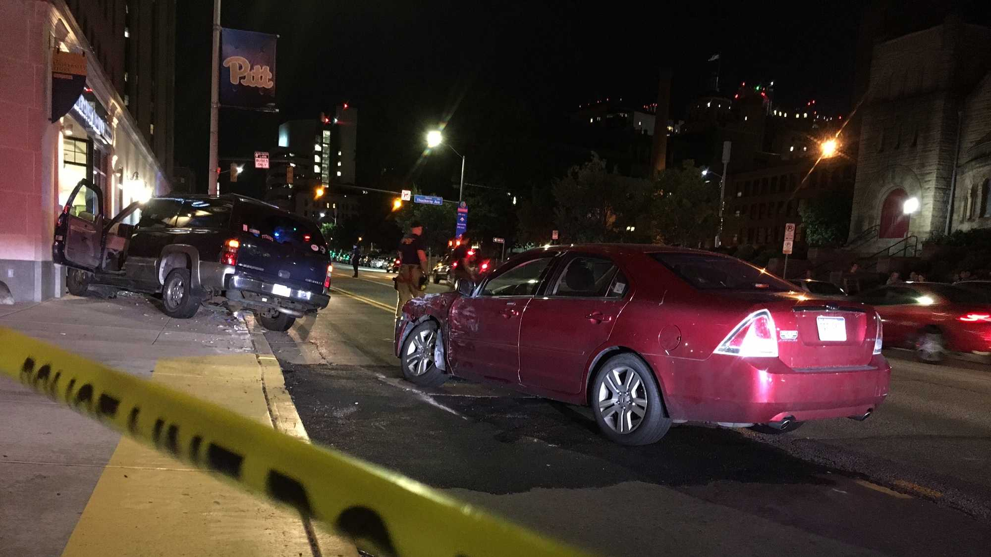 Three people were injured when a car crashed into a University of Pittsburgh bookstore late Saturday night.