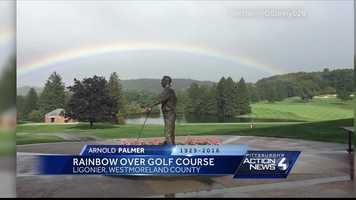Rainbow over the Arnold Palmer statue at Laurel Valley Golf Course in Ligonier, PA on the day of the private funeral service by the family