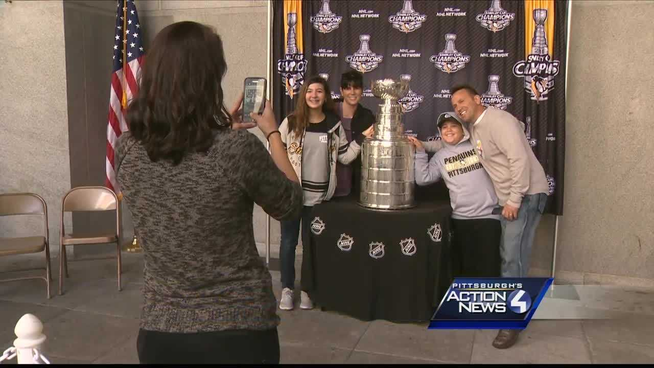 Fans pose with Lord Stanley at City-County Building downtown