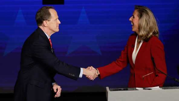 Pennsylvania U.S. Senate candidates Republican Sen. Pat Toomey, left, and Democrat Katie McGinty shake hands at the end of a debate at Temple University in Philadelphia, Monday.