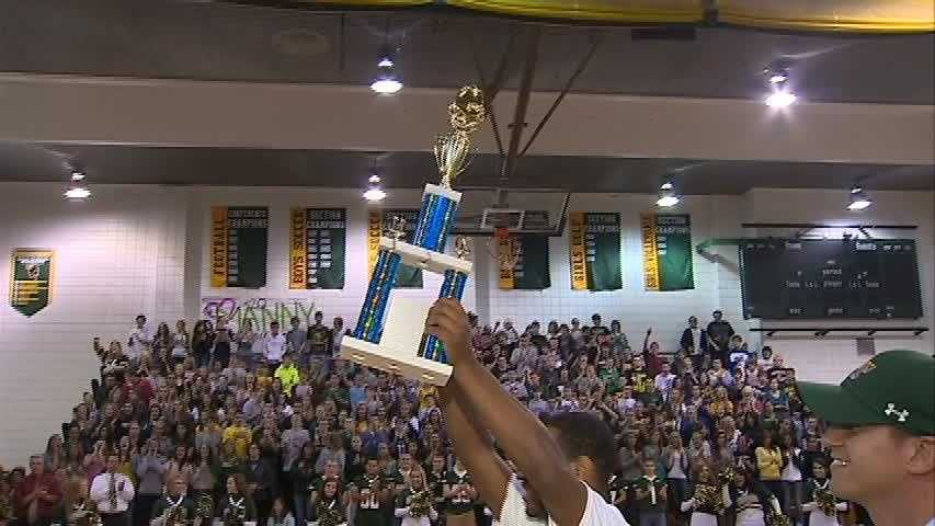 Manny Simpson holds up his Student-Athlete of the Week trophy for his Penn-Trafford classmates