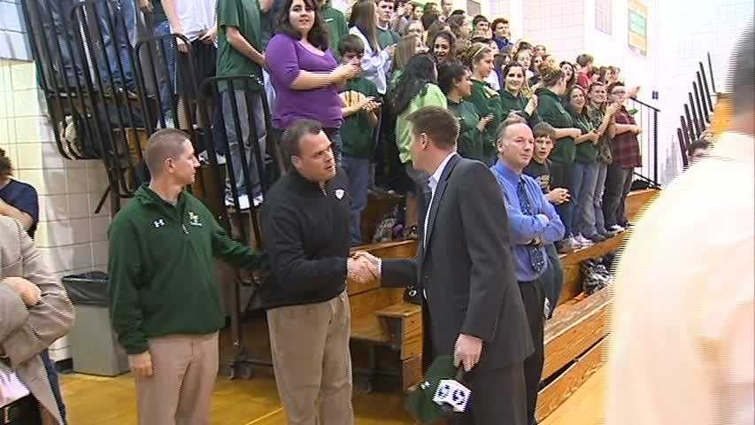 John Meyer shakes hands with Penn-Trafford head football coach John Ruane